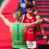 Winner Catriona Morrison from Scotland (left) welcomes home third place Joanna Lawn from New Zealand in the female section of the Ironman 70.3 Auckland. Photo / Richard Robinson