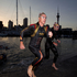 Australians Craig Alexander (left) and David Manwaring leave the swim during the Ironman 70.3. Photo / Richard Robinson