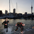 Professional men's section finish the swim during the Ironman 70.3 Auckland. Photo / Richard Robinson