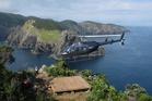 A Salt Air chopper takes off from atop Motu Kokako/Hole in the Rock. Photo/Peter de Graaf