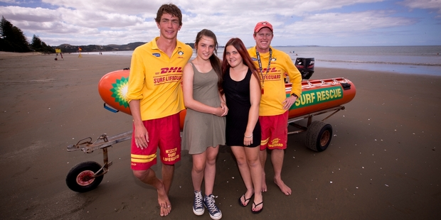 Lifeguards James Campbell (left) and Nick Tomkins helped to save Casey Trumper (second left), Ashleigh Neal and two would-be rescuers at Orewa Beach. Photo / Dean Purcell