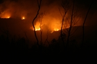 NIGHT BLAZE: Firefighters and residents spent an anxious night on Sunday as a large scrub fire blazed in Pipiwai.PHOTO/GRAHAM WRIGHT