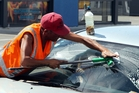 A windscreen washer in another city. In Rotorua anyone harassed by window washers can contact police as it is against council bylaws. Photo/File