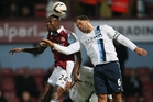 West Ham striker Carlton Cole (left) heads the ball under pressure from Man City defender Joleon Lescott as City cruise into the League Cup final. Photo / AP