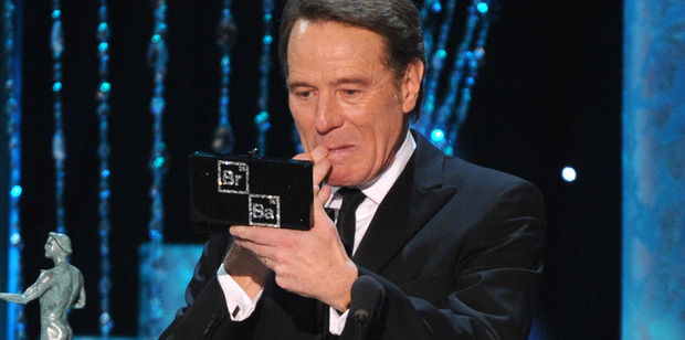 Bryan Cranston accepts the award for outstanding performance by a male actor in a drama series at the 20th annual Screen Actors Guild Awards. Photo/AP