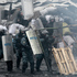A police officer aims his shotgun during clashes with protesters in central Kiev, Ukraine. Photo / AP