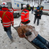 Paramedics carry a wounded protester on a stretcher away from clashes with police in central Kiev. Photo / AP