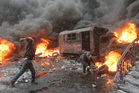 Protesters throw rocks at police in central Kiev, Ukraine. Photo / AP