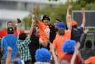 Fans celebrates a one handed catch and a chance to win one hundred thousand dollars at match 2 of the ANZ One Day International Cricket Series. Photo / Photosport.
