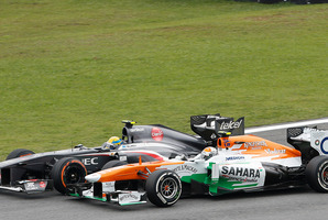 Sauber driver Esteban Gutierrez of Mexico, left, overtakes Force India driver Adrian Sutil of Germany, during the 2013 Brazilian Formula One Grand Prix. Photo / AP