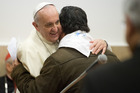Pope Francis hugs a faithful on the occasion of his visit to the Sacro Cuore church in Rome. Photo / AP