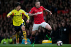 Manchester United's Alexander Buttner, right, vies for the ball against Sunderland's Ki Sung-Yueng during their English League Cup semifinal second leg soccer match. Photo / AP