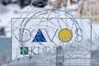 A fence outside the site of the World Economic Forum in Davos Switzerland. NZ finance minister Bill English hopes the issue of taxing the world's big tech companies will be addressed. Photo / AP