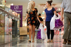 Consumer prices rose unexpectedly for shoppers in the December quarter. Pictured: Shanesse Renae (left) and Emma Good Christmas shopping at Auckland's Westfield St Lukes mall. Photo / Chris Gorman