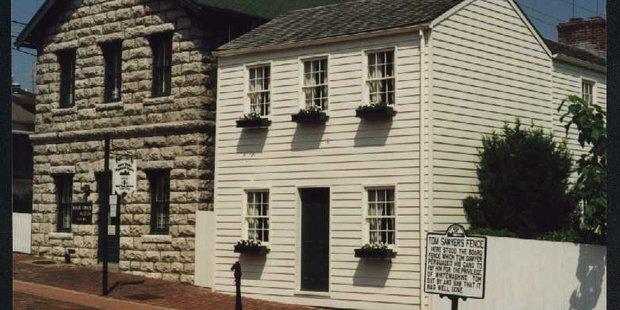 The original museum is next door to Mark Twain's white-painted boyhood home.