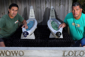 CLOSURE: John and Albie McGrath with the waka headstones crafted by John.PHOTO/JOHN STONE