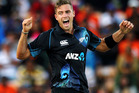 Tim Southee of New Zealand celebrates after taking the wicket of Rohit Sharma of India during the One Day International match. Photo / Getty Images.