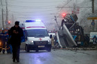 An ambulance leaves the site of a trolleybus explosion in Volgograd, Dec. 30, 2013. A militant group has claimed responsibility, and promised more for the Sochi games. Photo / AP