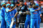 Tim Southee of New Zealand looks on as Indian players celebrate the wicket of Luke Ronchi. Photo / Getty Images