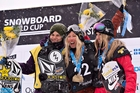 Christy Prior (centre) celebrates her gold with Cheryl Maas (left) and Austria's Anna Gasser in the women's snowboard slopestyle final in Canada yesterday. Photo / AP