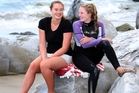 Lauren (left) and Hannah Williams are relaxed about their rescue of a family of five who were battered against the rocks at Mangawhai Beach. Photo/Michael Cunningham