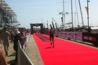 Crowds gathering at the finish line of the Ironman 70.3