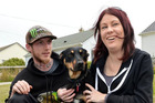 Housing New Zealand tenants Lara Elliott and Shane Wilson with their dog Mischief in Dunedin yesterday. Photo / Stephen Jaquiery