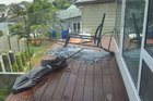 A heavy metal table is damaged during strong winds in Hillsborough. Photo / Nakita Daniel
