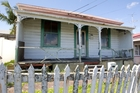 The house is likely to attract buyers who want to remove it and build on the 381sq m section. Photo / Jason Oxenham