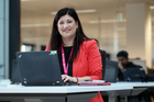 Wendy Hammonds from Spark hot desks with her laptop at Spark HQ in Auckland. Photo / Herald on Sunday