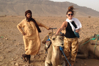 Nicky Park with a camel and guide in Morocco. Photo / Nicky Park