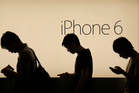 Apple denied the charge over bending, saying it had only received nine complaints in millions of sales. Photo / AP