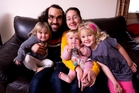 Iain and Bianca Davies with daughters (from left) Ecclesia, 2, Floriss, 1, and Anwen, 5. Photo / Dean Purcell