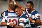 Junior Poluleuligaga of Auckland celebrates George Moala's try. Photo / Getty Images
