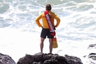 A Mount surf lifeguard scans the ocean for signs of the missing boy off Mauao. Photo / John Borren