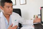 The hospital's senior professor of surgery, Bahadir Bebezov examines the hair ball. Photo / YouTube