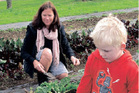 Kerikeri Kindegarten 4-year-old Liam Curtis and helper Ali Carnaby at work in the community garden