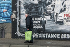 Belfast's Falls Rd murals are attractions for tourists, everyday life for locals. Photo / Ewan McDonald