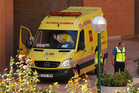 An ambulance outside the Madrid apartment of the Spanish nurse infected with Ebola. Photo / AP