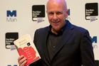 Man Booker prize 2014 winner Australian author Richard Flanagan holds his book The Narrow Road to the Deep North. Photo / AP