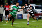 Nathan Tudreu of Manawatu attempts to beat the defence of Shannan Chase of Hawke's Bay. Photo / Getty Images