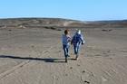 Let the kids  run free in the desert-like dunes of Port Waikato. Photo / Dani Wright