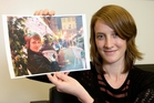Alison Herft in Wellington with a photograph of her in Edinburgh taken with the returned camera. Photo / Mark Mitchell