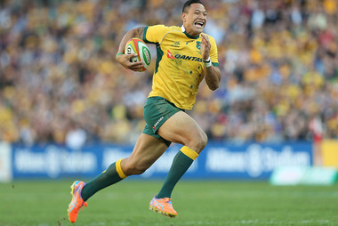 Israel Folau of the Wallabies celebrates as he runs in to score a try against France in June. Photo / Getty  Images
