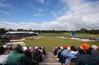 The gallery watches as Adam Scott of Australia putts on the 18th green during day four of the World Cup of Golf at Royal Melbourne Golf Course. Photo / Getty Images