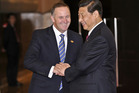 John Key meeting with Chinese Premier President Xi Jinping at a previous event in 2013. File photo / supplied