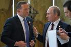 Australian Prime Minister Tony Abbott and Russian President Vladimir Putin meet at the Apec summit. Photo / AP