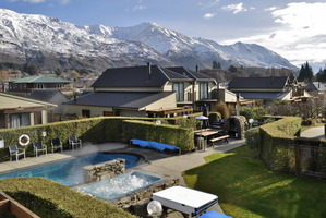 An outdoor spa in the centre of the complex is the perfect remedy for sore apres-ski muscles, while the larger pool offers respite from the Central Otago heat during summer. Photo / Supplied