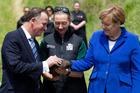 John Key introduces Angela Merkel to a kiwi. Photo / Claire Trevett