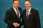 Prime Minister of Australia Tony Abbott , left, welcomes John Key to the G20 summit in Brisbane, where climate change has been one of the major issues. Photo / AP